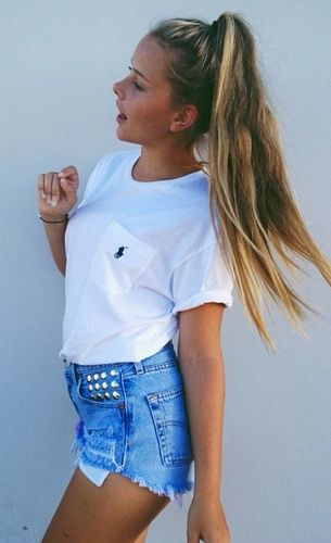 Combining edgy and preppy summer look high waist vintage shorts white tshirt ponytail