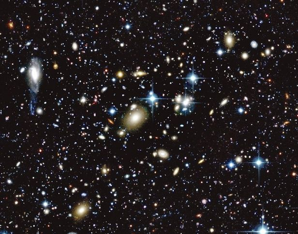 WHY is the space between galaxies black? --In order to see light, something must be producing the glow, but the space between galaxies is largely empty so we observe this space to be black. Despite the fact that there is some material between galaxies, strung in a cosmic web, the density of this material is very low and any light that is emitted or reflected would be incredibly faint in comparison to that which we can see from galaxies.