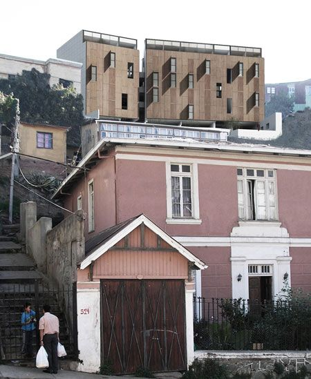 Chilean studio Duarte Arquitectos designed an apartment building for a hill-top in Valparaiso, Chile.