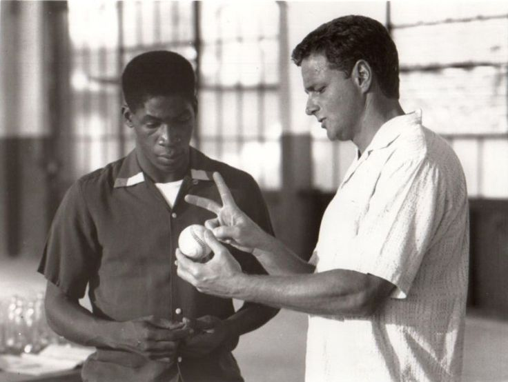 William Russ (before he played Alan on Boy Meets World) was a washed-up minor-league baseball player (Roy Dean Bream) with Glenn Plummer (as Tyrone Debray) in the movie Pastime (1991)