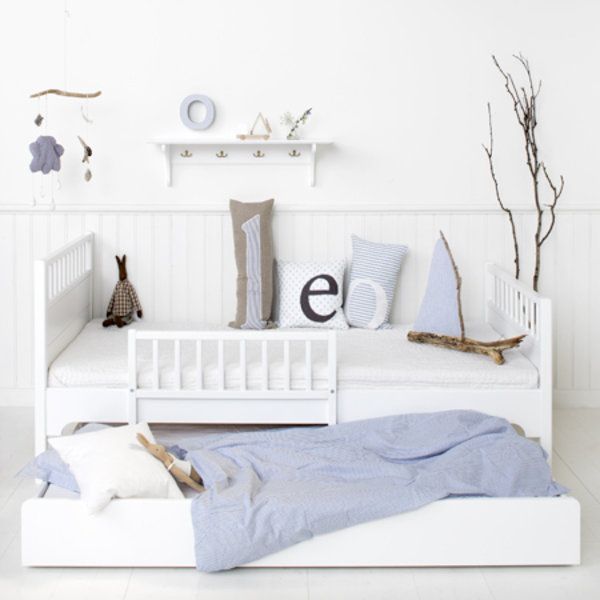 White laquered childrens single bed with guard rail and pull out trundle drawer
