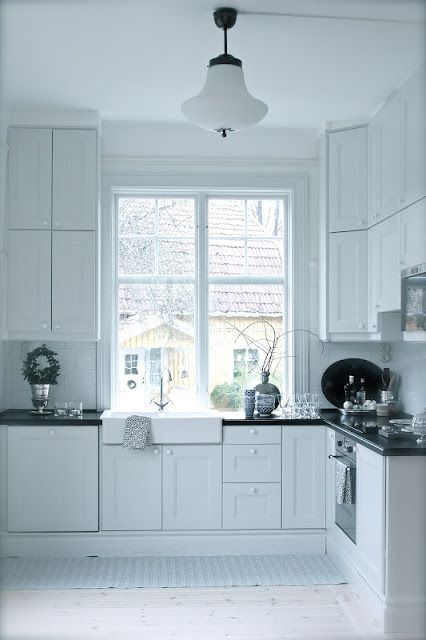 Trend White cabinets brown counter top white subway tiles Ikea kitchen