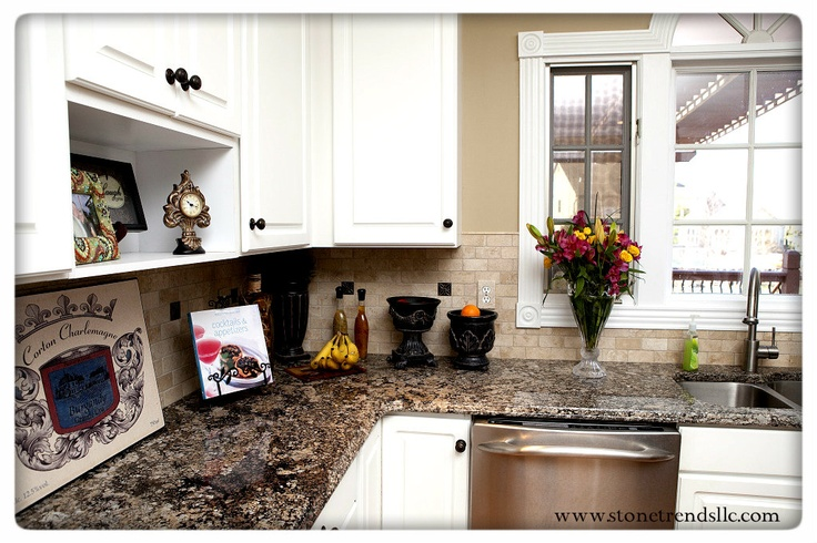 This stunning Coral Gold Granite countertop is an astonishing addition to a kitchen with beautiful white cabinets and stainless steel appliances. The fabrication was done by Stonetrends.