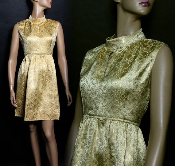 This is a fabulous 1960s dress and what a striking shimmering gold color it has. A blast from the past of those glorious days. Opulent brocade