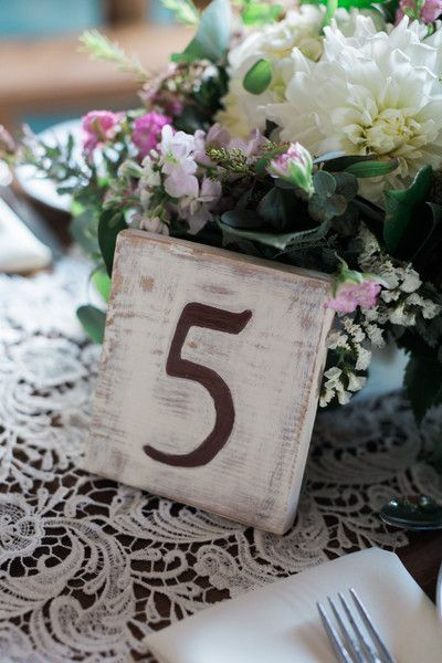 Wedding table numbers engraved into pretty pieces of wood. Perfect for a rustic, barn wedding! {Jeremy Chou Photography}