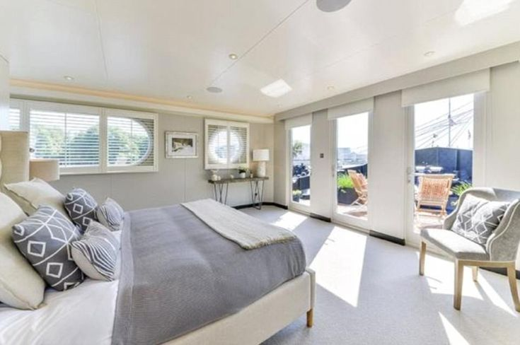 Barging about?! A master bedroom in barge conversion enjoys stunning views of the Thames - all from the comfort of a luxurious double bed Feb'18