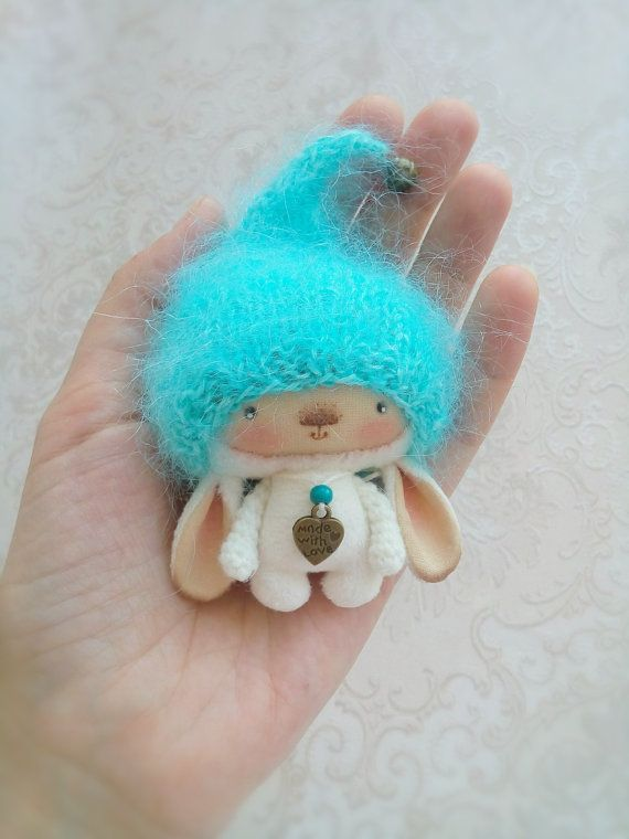 Little plush rabbit in fluffy turquoise hat by OlgaNeroDolls