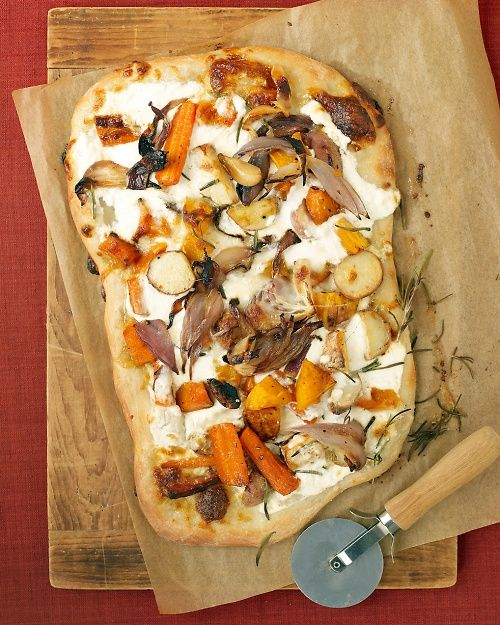 Roasted Fall Vegetable and Ricotta Pizza is topped with sweet butternut squash, red onions, and potatoes.