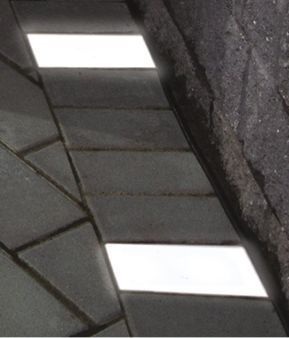 These paver lights are a must-have for any backyard patio!  Cambridge Pavingstones with Armortec Paver Lights