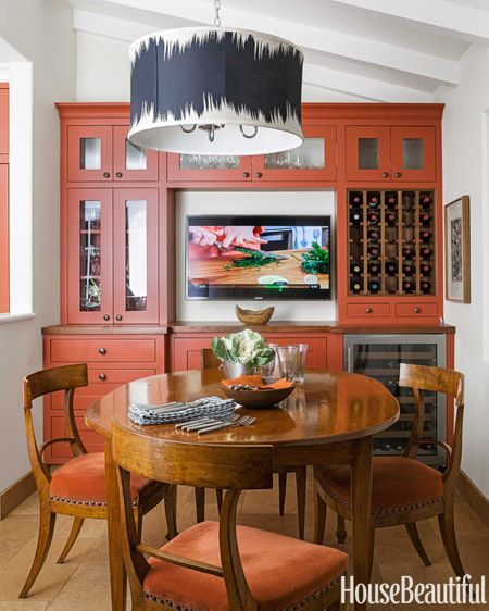 A bold burnt orange kitchen in hillsborough california for Burnt orange kitchen cabinets