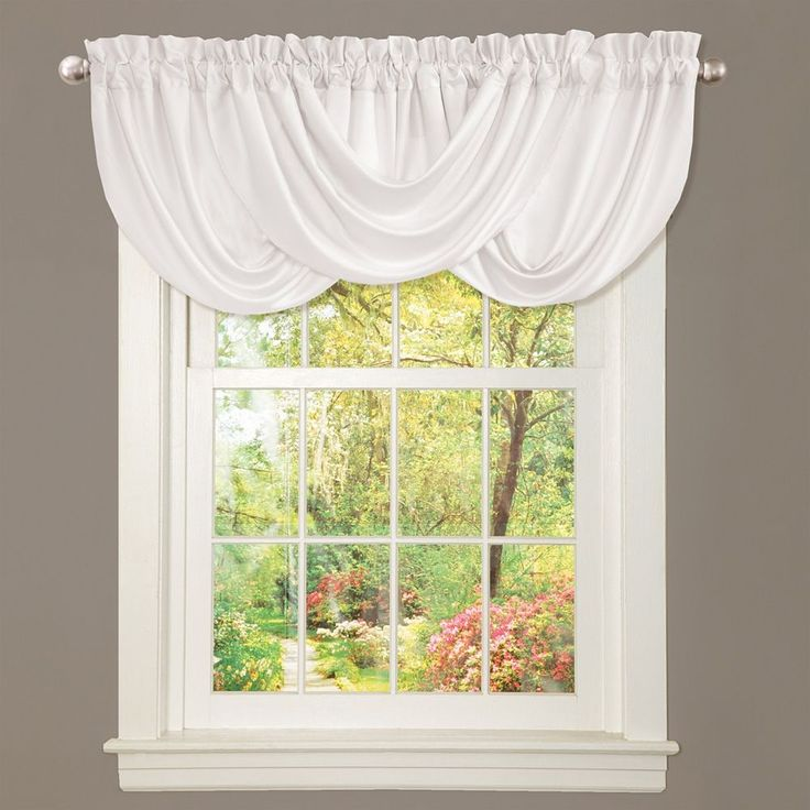 This beautiful window valance makes an excellent top piece to any window in your home. Featuring white curtains with a rod pocket installation, the valance creates a soft accent that will add character. The curtains are made of durable poly fabric.