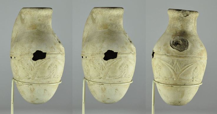 Libation vase faience vessel, 9th-7th century B.C. Libation vase faience vessel, Mesopotamian Levantine faience vessel molded with flowers and leaves, egyptianizing, spout missing and holes in sides, 15 cm high. Private collection