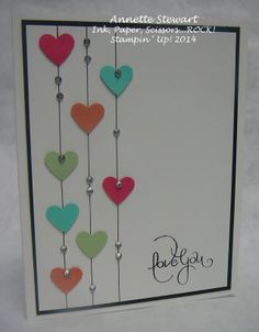 February 23, 2014 | Simply draw lines (using a ruler) and punch out a few hearts...  Of course you have to add a little bling so pop on some Rhinestones and you have such a sweet card!  Love Ya came form the Best of 25...