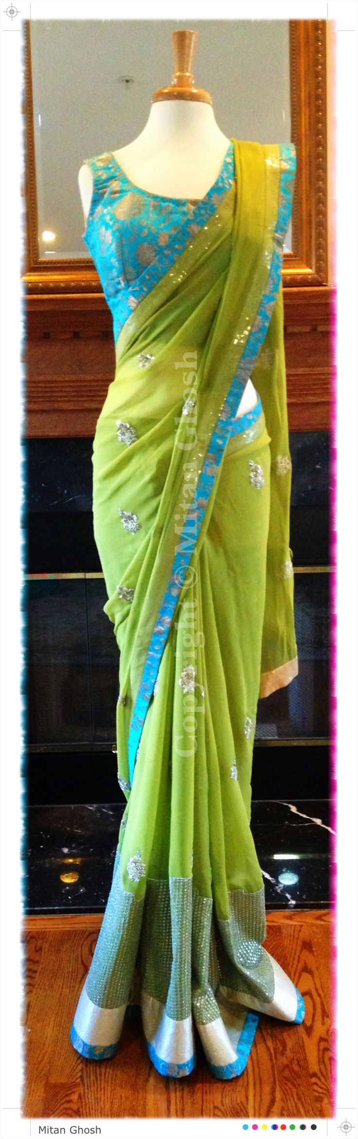 Green georgette saree with dabka motifs. Blouse is made of Banarsi khinkhwaab.
