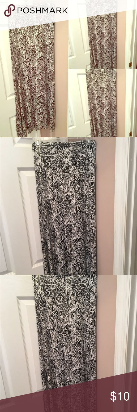 Black/White Aztec maxi skirt Size S $10 Maxi Skirts are great for Spring!!! Add a colorful top and you are ready for going out!! Never Been Worn! Size S $10 Skirts Maxi