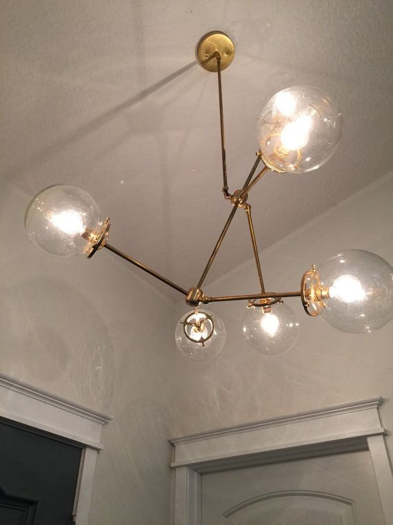 The hare solid brass with glass globe chandelier light for Dining room globe lighting