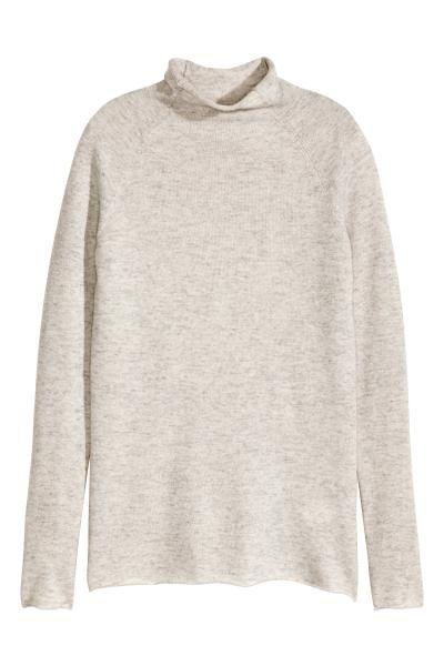 Camisola de caxemira: QUALIDADE PREMIUM. Camisola em malha fina de caxemira macia com meia gola, mangas raglan compridas e orlas enroladas.