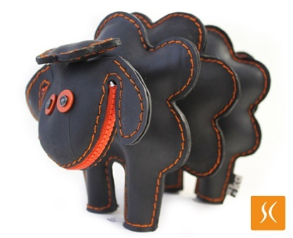 """Rubber Sheep by Ricardo Geldres Piumatti & Kareen Nishimura Doy: Made of reclaimed rubber inner tube in Peru. Also available in blue, green, orange and yellow. 9 x 6.5"""", $49"""