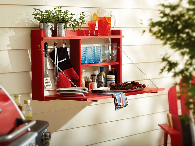 Red Outdoor Buffet Cabinet open and hanging on a wall outside... Staining mine to match our deck! Making it this weekend!