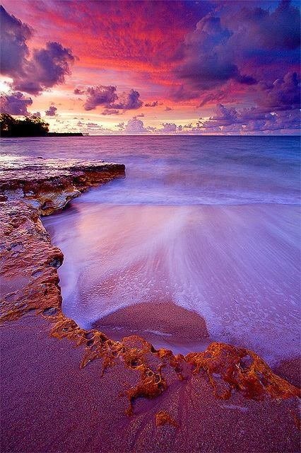Nightcliff Beach lit up after sundown, Australia