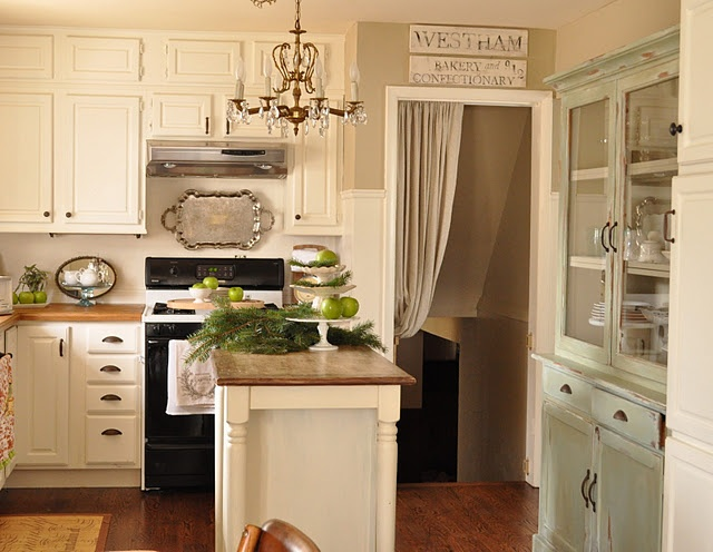 The walls are benjamin moore bennington grey the cabinets are linen white which is a warm Colors for kitchen walls