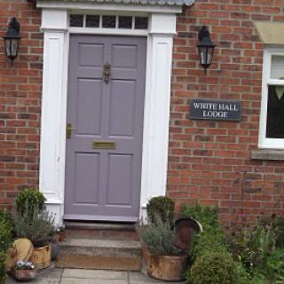 My front door painted in Farrow & Ball Brassica.... we get lots of nice comments about the colour..try it