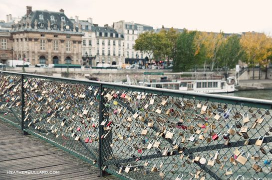 In paris couple write their names or initials and special for Love lock bridge in paris