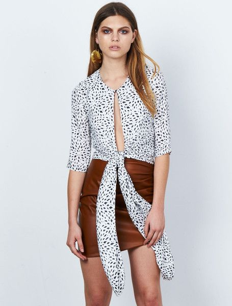 ISLA FRACTAL PRINT TOP from the Stardust Collection. All tied up. This monochrome printed blouse has a neck to waist slit, a statement waist-defining tie, and cropped ¾ sleeves, making it one of those effortlessly elegant pieces. Simply slips on, with a single button and loop neck closure. Available: www.islalabel.com #islalabel #fashion #style #winter #simple #monochrome #blouse #printed #elegant