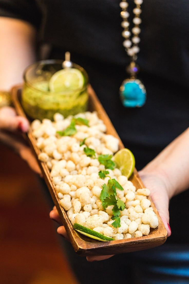 Fried Hominy with Cilantro Pepita Pesto - This Fried hominy recipe from Southern Living served with a bright cilantro pepita pesto sauce to drizzle over top of the crisp, fried hominy is perfect for entertaining. @Southern Living