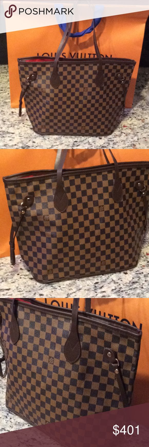 new Louis Vuitton size mm damier neverfull Just make an offer All reasonable offers will be considered I will go much lower than the listed  This is a brand new Louis Vuitton size mm damier neverfull  this is a good quality INSPIRED or NOT AUTH piece i think bc i can't find a date stamp in it so I will sell this piece at a fraction of the cost of a real. The shopping bag in the background is not sold with this purse Louis Vuitton Bags Totes