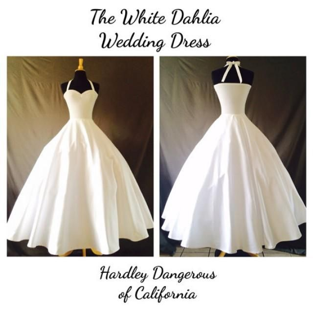 Say I Do in style with The White Dahlia halter wedding dress! This lovely Fit n Flare swing dress combines the comfort of stretch knit and the