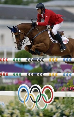 Team USA's Richard Fellers and Flexible during the individual Show Jumping competition today with a clear ride. (Photo credits: David Goldman & the Associated Press)