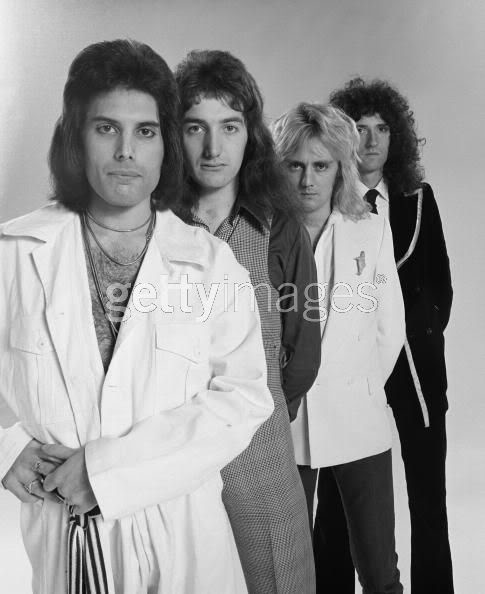 Queen.  Poor Brian is off in Siberia to try to make him the same height as the others.