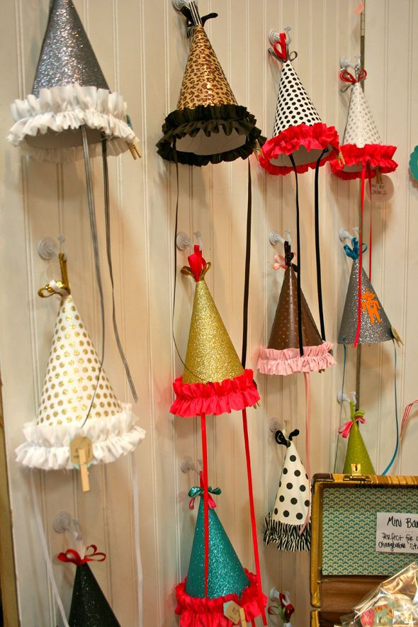 I love the idea of the each girl getting to pick their own birthday hat to wear at the party