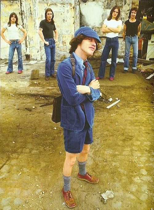 Angus Young of AC/DC I like how they lined the four of them in the back
