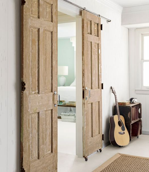 The track alone on sliding barn-style doors can cost hundreds of dollars,   but Emily cleverly fashioned her own using caster wheels and plumbing pipes.