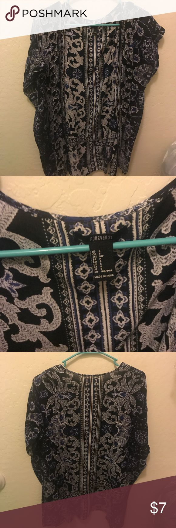 Tribal print short-sleeved cardigan// Forever 21 Tribal print cardigan for forever 21. Size Small. Perfect condition. Comes to about mid thigh on me and I am 5'4. Thanks for shopping!!💕 Sweaters Cardigans
