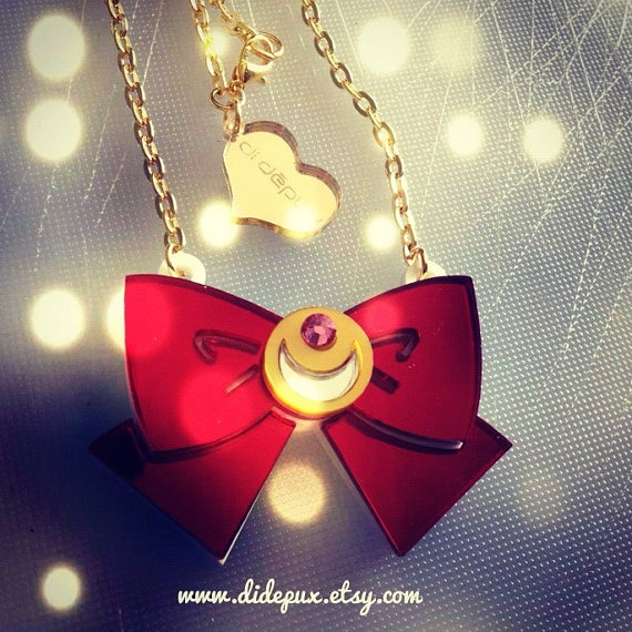 Sailor moon bow red mirror laser cut necklace. €20,00, via Etsy.  http://www.etsy.com/listing/112023362/sailor-moon-bow-red-mirror-laser-cut?
