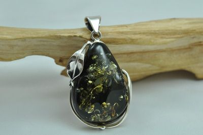 Fantastic green amber pendant with pear drop shape amber set in sterling silver.