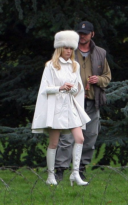 January Jones as Emma Frost, between takes on *X Men -- First Class*. Betty Draper's kicking metaphorical six o'clock and taking names...in style!