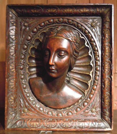 A late th century fruit wood panel depicting carved