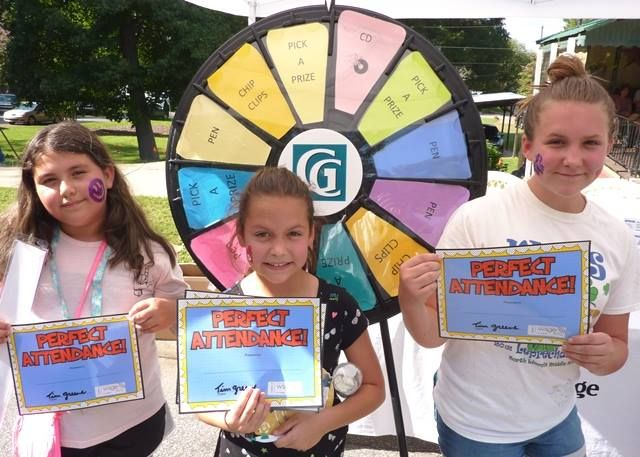 This group just loved their Perfect Attendance Certificates! Read more about the Prize Wheel at https://PrizeWheel.com/blog/.
