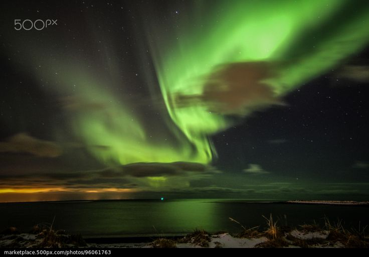 Northern Lights over the sea - stock photo