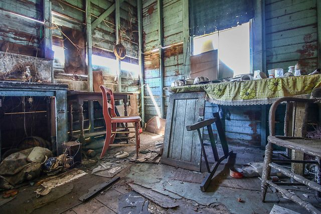 Inside the abandoned Hoarders House, tucked away in Brisbane, had a dining table, which consisted of  many cups and cutlery on top of the vintage table cloth. There where also face masks and other interesting items hidden.
