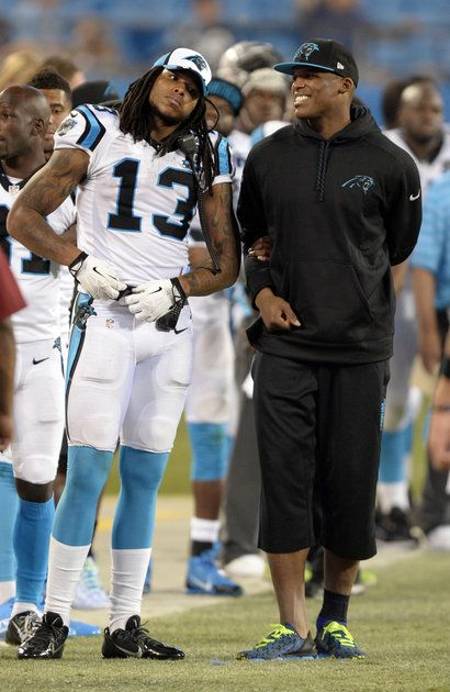 WR Kelvin Benjamin (13) and QB Cam Newton (1) watch their teammates against the Kansas City Chiefs in the second half of their pre-season game at Bank of America Stadium on Sunday, August 17, 2014. The Panthers won, 28-16.