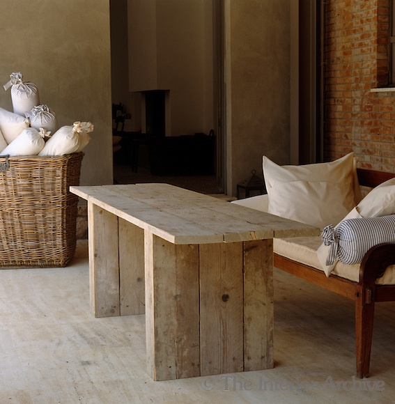 A table fashioned from old scaffolding boards