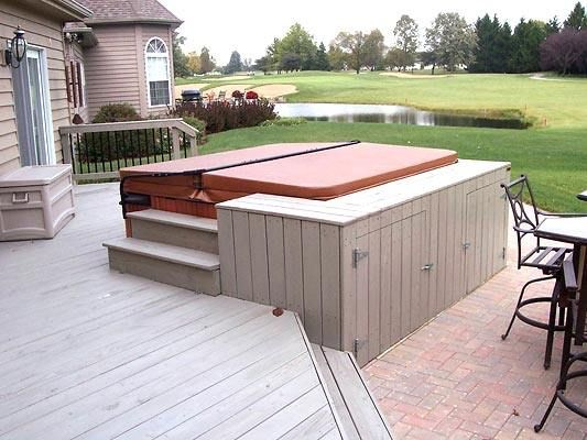 A Wood Spa Deck With Paver Patio In Wadsworth Il Pool