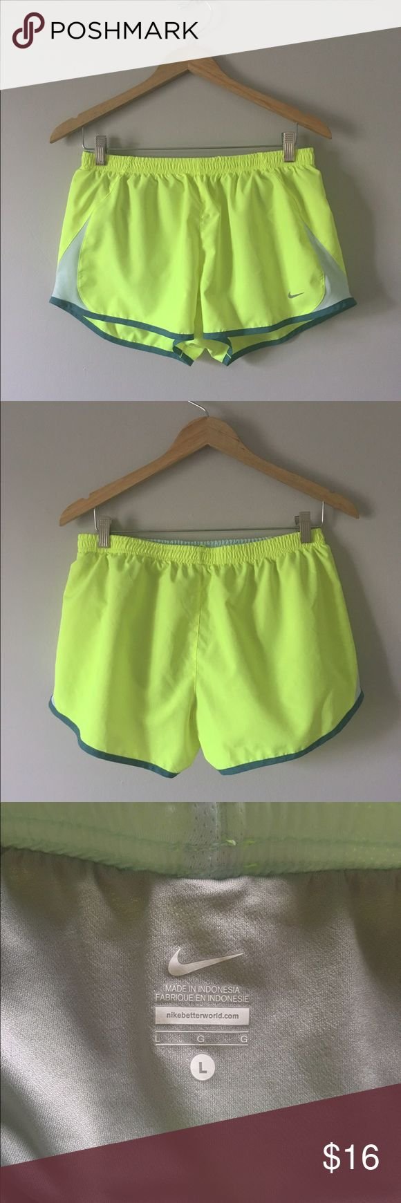 Women's Nike Running Shorts Size L For sale is one pair of Large Women's Nike Running Shorts. Barely used and in great condition. They have sewn in panties. These shorts are neon yellow with a silver stripe down the sides and dark teal piping. Make me an offer or bundle and save! Nike Shorts