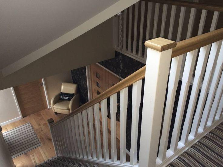 Basic Staircase with Oak Handrail and Pine Stop Chamfered Spindles: rustic Corridor, hallway & stairs by StairBox