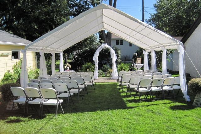 Cheap Backyard Wedding Ideas wood chairs set up in backyard for wedding ceremony around pergola and pathway Backyard Wedding One Of The Most Affordable Wedding Venues I Like This For The Ceremony Wedding Planning Ideas Pinterest Backyard Weddings